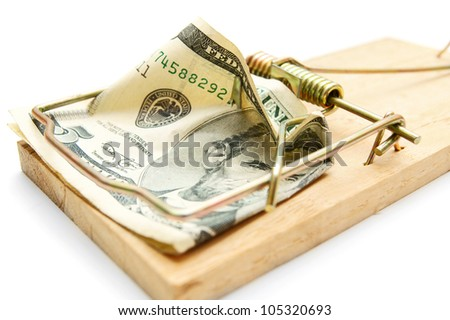 Money in a mousetrap. On a white background. - stock photo