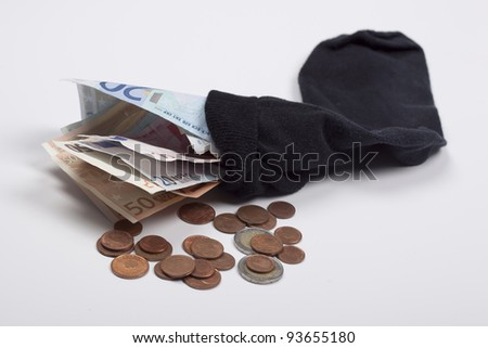 money in a old sock - stock photo