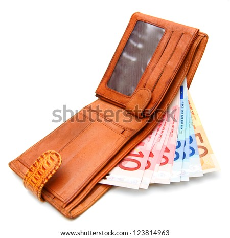 Money in a purse. On a white background. - stock photo