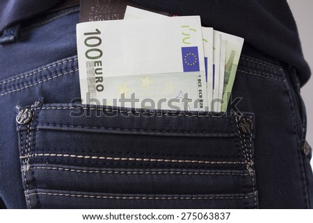 Money in back pocket in jeans. Concept: Savings, spending , euros  - stock photo
