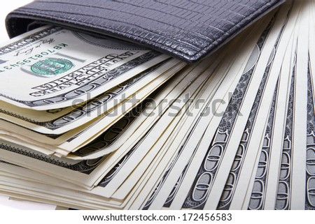 Money in black leather wallet, closeup - stock photo
