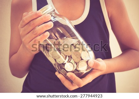 money in children's hands with filter effect retro vintage style - stock photo