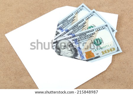 Money in envelope on wooden background. - stock photo