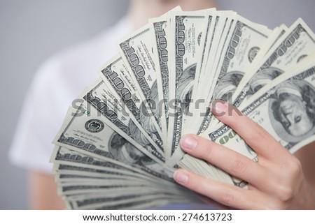 Money in female hands - stock photo