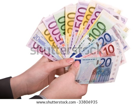 Money in female hands. Isolated. - stock photo