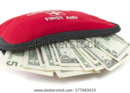 Money in First aid emergency kit - stock photo