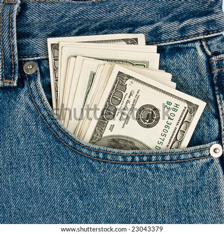 Money in  front-pocket  of jeans - stock photo