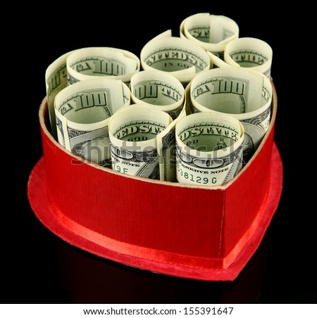 Money in gift box on dark color  background - stock photo
