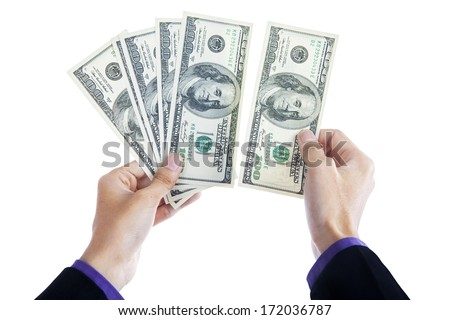 Money in human hands isolated on white background - stock photo