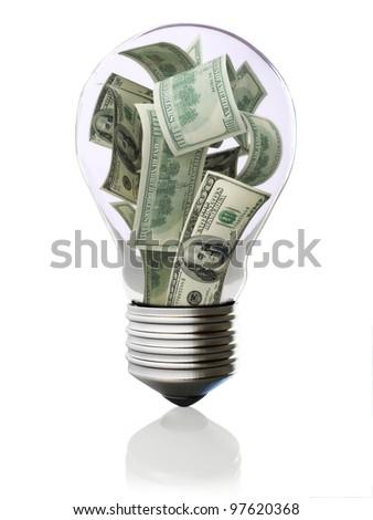 Money in light bulb concept - stock photo