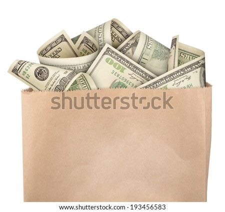 Money in paper bag isolated on white background - stock photo