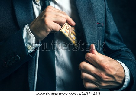 Money in pocket, businessman putting euro banknotes in suit pocket, bribe and corruption concept. - stock photo