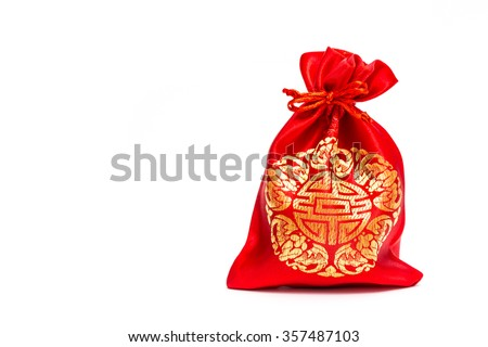 Money in Red bag for Chinese New Year on white background - stock photo