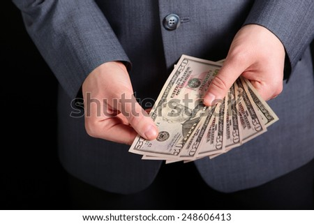 money in the hands of a businessman - stock photo