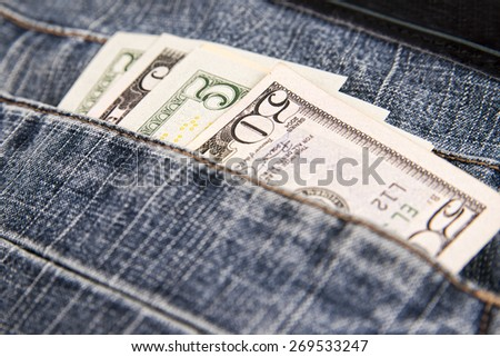 Money in the jeans pocket. Dollars bills - stock photo