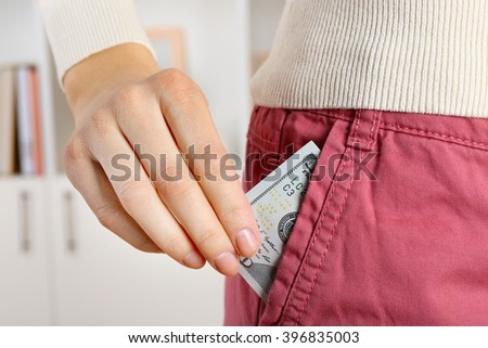 Money in the pink pocket, close up - stock photo