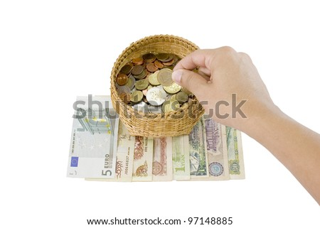 Money is put by hand in to the basket save money concept. - stock photo