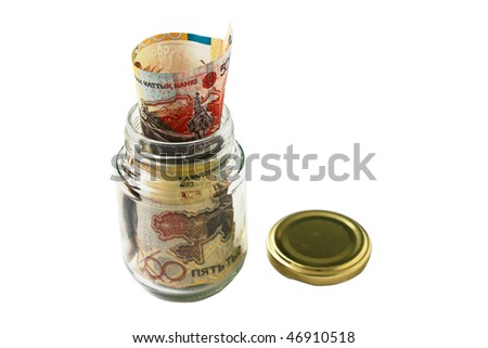 Money Kazakhstan. Packed in a glass jar. Close-up. Isolation on a gray background. - stock photo