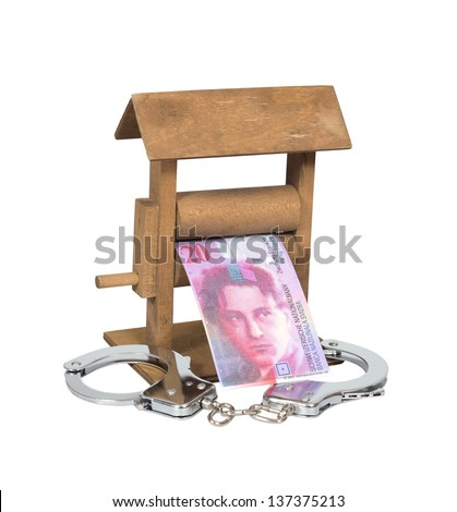 Money laundering. Swiss Franc bill in the wringer with handcuffs isolated over white, clipping path included. - stock photo