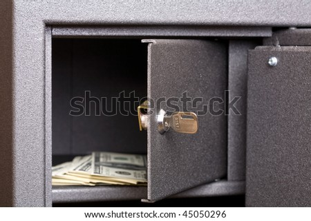 Money lying in the open safe - stock photo