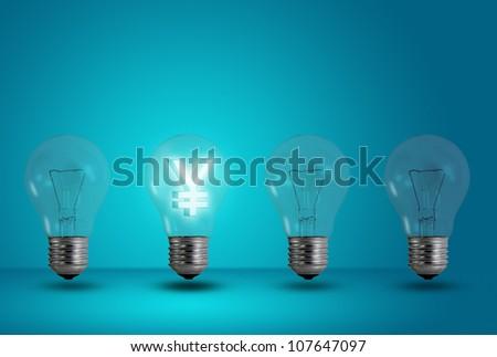 Money making idea. Yen symbol glow among other light bulb on a blue background - stock photo