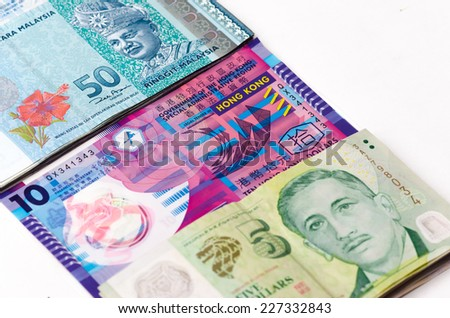 Money of Asia are Singapore, Malaysia and Hongkong on the white background, close up - stock photo