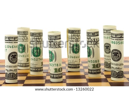 Money on chess board, isolated on white background - stock photo