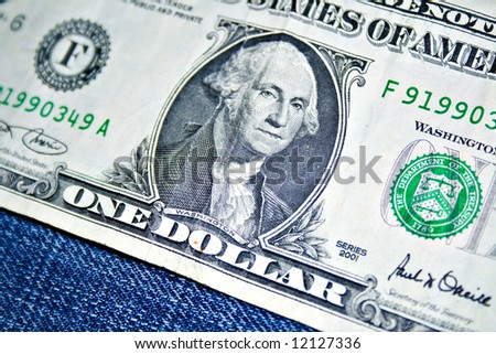 Money on jeans canvas - stock photo