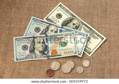 money on linen cloth background. - stock photo