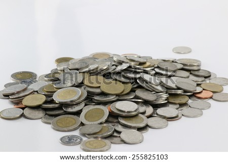 money on the table,coin stack isolated on white background. - stock photo