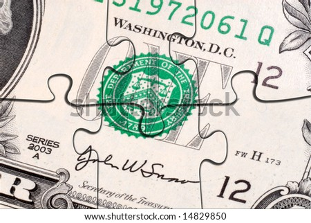 Money puzzle:  A close up of the American One Dollar Bill with six puzzle pieces. - stock photo