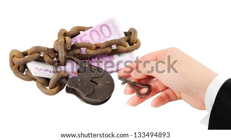 money security concept - hand with key try to unlock money - isolated on white background - stock photo