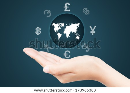 Money Sign around the wold map on a woman's hand - stock photo