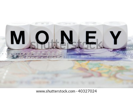 Money spelled in letter cubes on a twenty and ten pound note. - stock photo