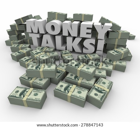 Money Talks words in white 3d letters surrounded by staks or piles of dollars illustrating the power and influence of wealth - stock photo