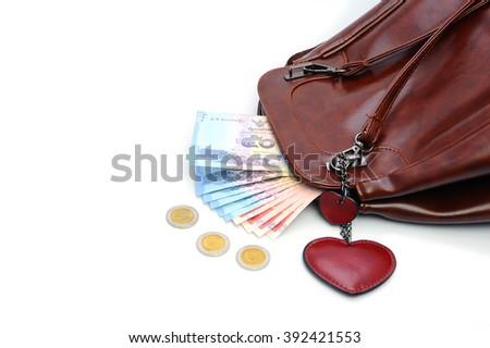 money, thai bath and Women bag on white background - stock photo