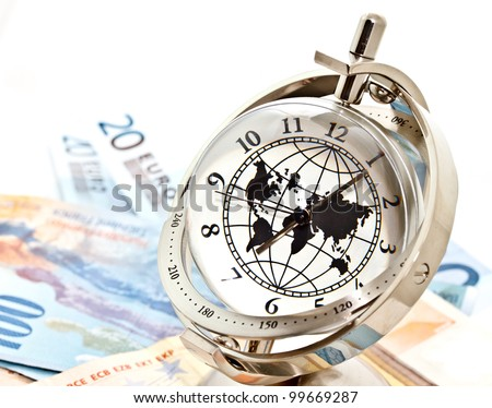 money, time and globalization concept; global model clock with Euro banknotes on white background - stock photo