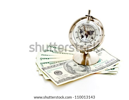 money, time and globalization concept; global model clock with US dollar banknotes - stock photo