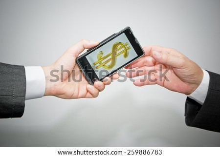Money transfer in dollars with mobile phone concept, close up - stock photo