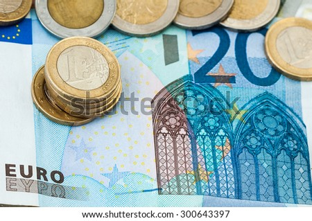 Money twenty Euro Bill Coins one and two Euro Coins - stock photo