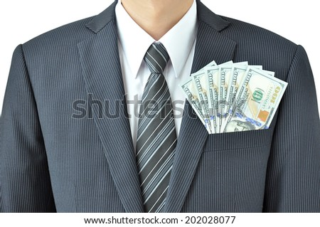 Money - United States dollar (or USD) banknotes in businessman suit pocket - stock photo