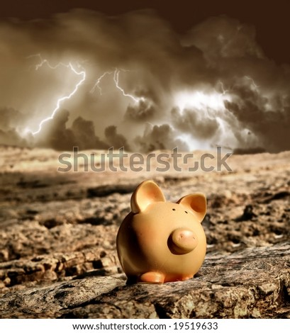 moneybox and a storm - stock photo