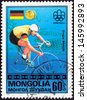 """MONGOLIA - CIRCA 1976: A stamp printed in Mongolia from the """"Olympic Games, Montreal. Gold Medal Winners"""" issue shows Gregor Braun of West Germany (cycling), circa 1976.  - stock photo"""