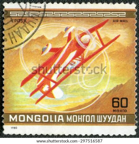 MONGOLIA - CIRCA 1980: A stamp printed in Mongolia shows aircraft Pits, Canada, series 10th World Aerobatic Championship, Oshkosh, Wisconsin, August 17-30, circa 1980 - stock photo