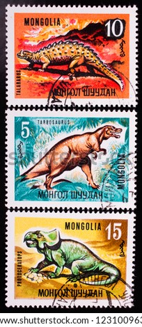 MONGOLIA - CIRCA 1967: A stamp printed in Mongolia shows three kinds of different dinosaurs , circa 1967. - stock photo