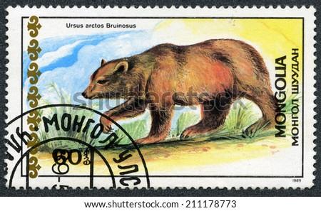 "MONGOLIA - CIRCA 1989: A stamp printed in Mongolia shows Tibetan blue bear, ""Bears"" series, circa 1989 - stock photo"