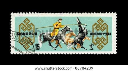 MONGOLIA - CIRCA 1965: A stamp printed in the MONGOLIA, shows Horsemen on horses,  circa 1965 - stock photo