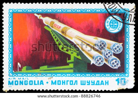 MONGOLIA - CIRCA 1975: An airmail stamp printed in Mongolia shows a space ship, series, circa 1975. - stock photo