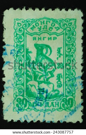 Mongolia Shuudan - Circa 1958: Postage stamp printed in Mongolia slaked shows an image of a mountain goat graphics green on a white background - stock photo