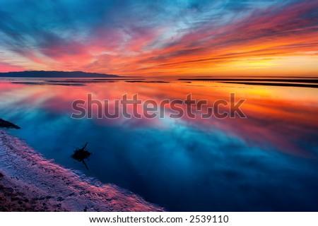 Mongolia sunset on lake - stock photo